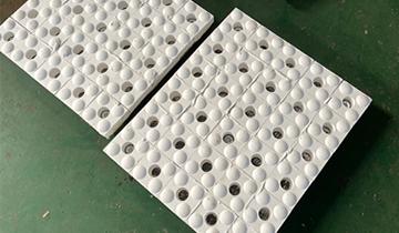 耐磨陶瓷衬板公司生产的是三合一陶瓷衬板吗?